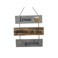 LOVE GROWS IN THE GARDEN WALLHANGER 30CM